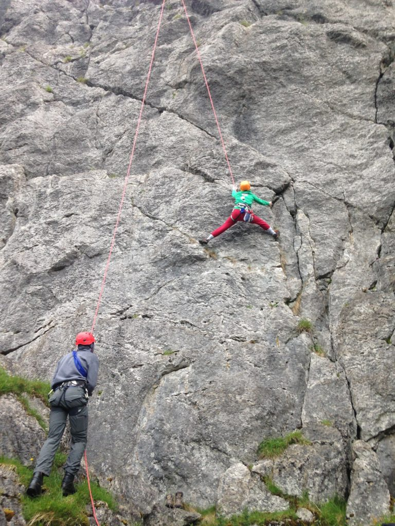 Tackling a challenging route on top rope at Tormore in Glencar