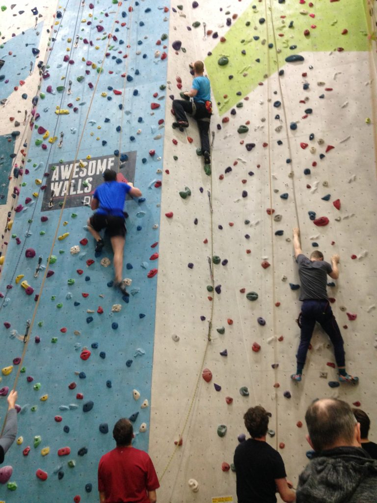 Three climbers scaling the 12 metre indoor wall at Awesome Walls, Dublin