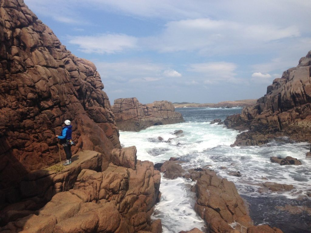 Climbing at Cruit Island Donegal with churning seas all around